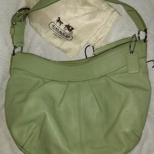 Authentic cursive Coach F13731 with dust cover